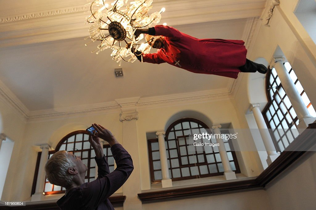 Annie Lennox photographs an effigy of Archbishop Emeritus Desmond Tutu after she addressed the Cape Town Press Club on May 2, 2013 in Cape Town, South Africa. Lennox, in response to what she calls 'the epidemic of violence' in South Africa against women and girls, has launched a petition imploring the South African media, key government officials and religious leaders to make a commitment of personal and professional responsibility in order to ensure that the issue of gender based violence is never marginalised again.
