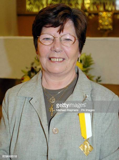 Annie Maguire wears the medal that was presented to her by the Archbishop of Westminster Cardinal Cormac MurphyO'Connor