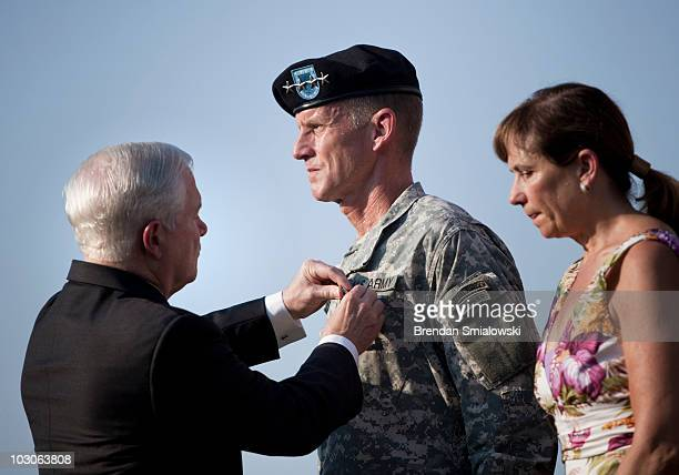 Annie McChrystal stands with her husband Gen Stanley McChrystal as he is awarded the Department of Defense Distinguished Service Medal by Secretary...