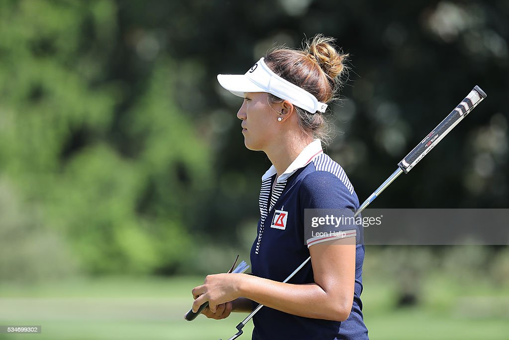 Annie Park from the United States looks at the leaderboard on the ninth hole during the second round of the LPGA Volvik Championship on May 27, 2016 at Travis Pointe Country Club Ann Arbor, Michigan.