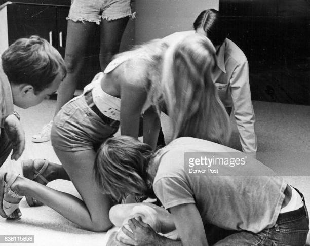 AUG 10 1974 AUG 14 1974 'ATOMIC Annie' Used To Help Teach Resuscitation Methods Students working with the dummy or e Diane Brown and Tony Pranaitis...