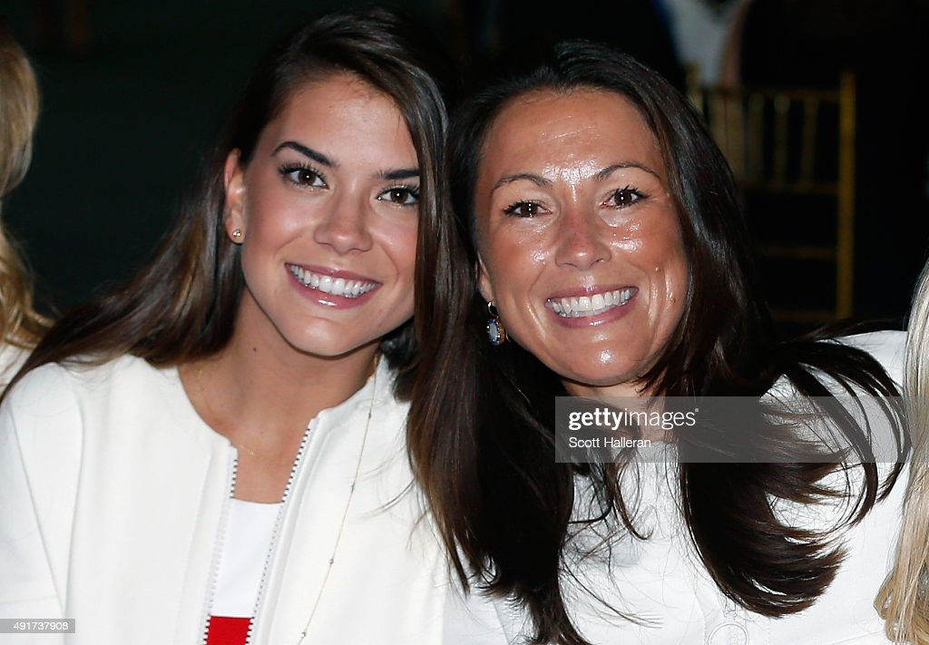 Annie Verret and Sybi Kucher of the United States pose for a picture during the opening ceremony of the 2015 Presidents Cup at the Convensia Ceremony Hall on October 7, 2015 in Incheon City, South Korea.