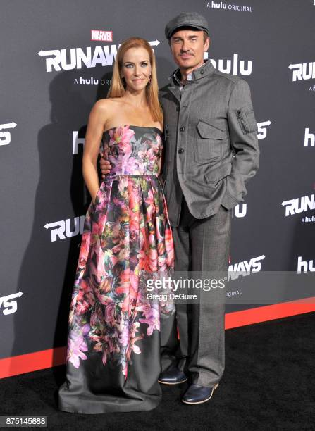 Annie Wersching and Julian McMahon arrive at the premiere of Hulu's 'Marvel's Runaways' at Regency Bruin Theatre on November 16 2017 in Los Angeles...