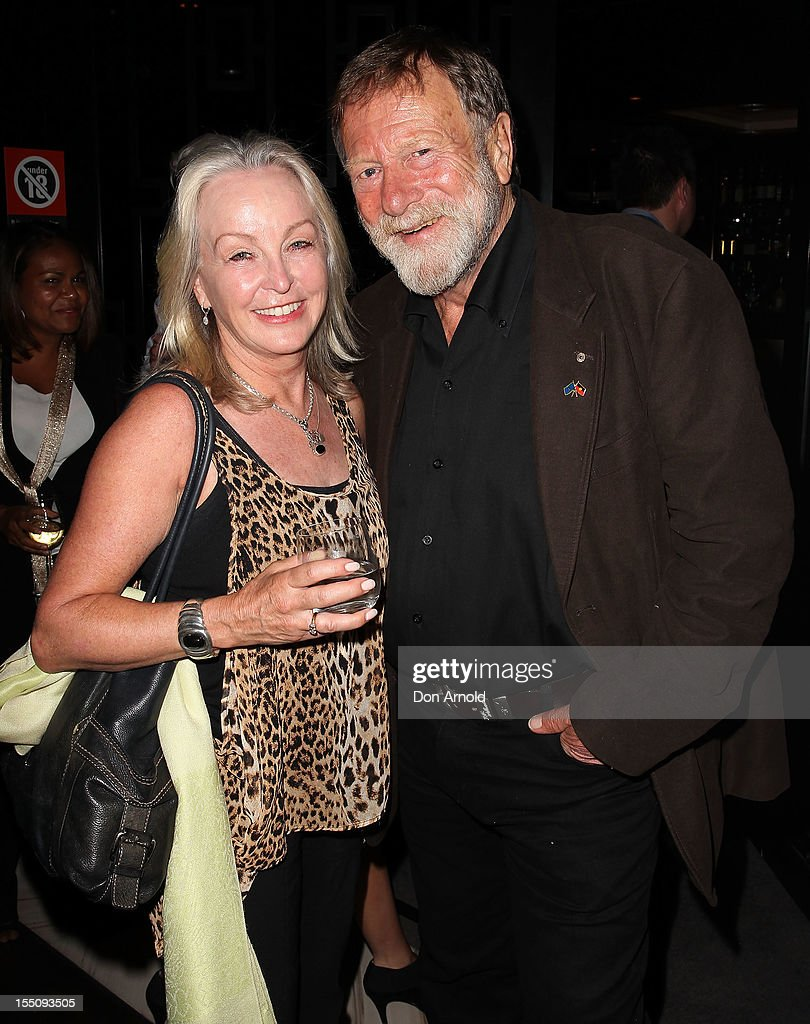 Annie Wright and <a gi-track='captionPersonalityLinkClicked' href=/galleries/search?phrase=Jack+Thompson&family=editorial&specificpeople=210750 ng-click='$event.stopPropagation()'>Jack Thompson</a> pose at the book launch of 'Nomad Two Worlds' by Russell James on November 1, 2012 in Sydney, Australia.