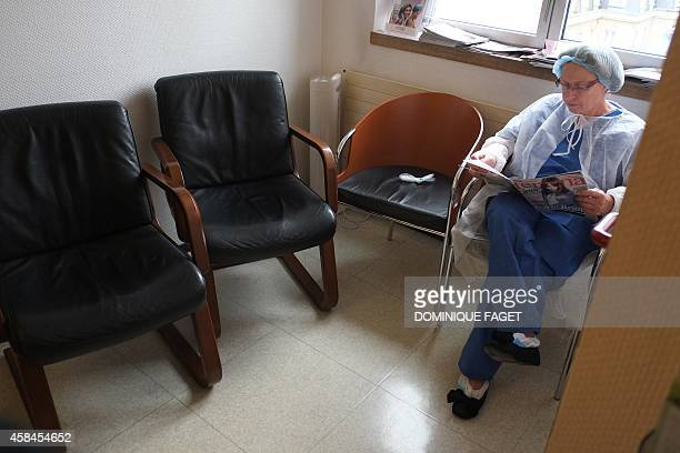 AnnieClaude Gomont a woman suffering from breast cancer waits for her surgery at the oneday surgery department of the French hospital institut Curie...