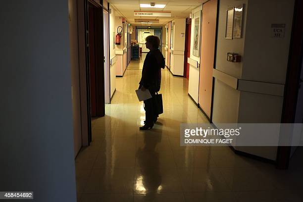 AnnieClaude Gomont a woman suffering from breast cancer waits for admission to the oneday surgery department of the French hospital institut Curie...