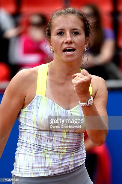 Annika Beck of Germany celebrates after winning her first round match against Nina Bratchikova of Russia during day four of the Nuernberger Insurance...