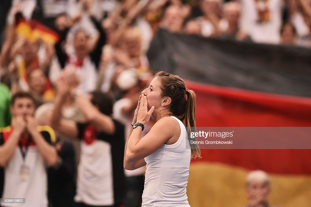 <a gi-track='captionPersonalityLinkClicked' href=/galleries/search?phrase=Annika+Beck&family=editorial&specificpeople=6249693 ng-click='$event.stopPropagation()'>Annika Beck</a> of Germany celebrates victory in her match against Timea Bacsinszky of Switzerland on Day 2 of the 2016 FedCup World Group Round 1 match between Germany and Switzerland at Messe Leipzig on February 7, 2016 in Leipzig, Germany.