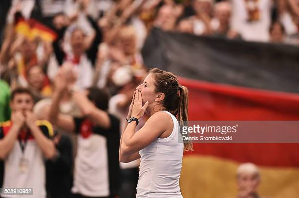 Annika Beck of Germany celebrates victory in her match against Timea Bacsinszky of Switzerland on Day 2 of the 2016 FedCup World Group Round 1 match...