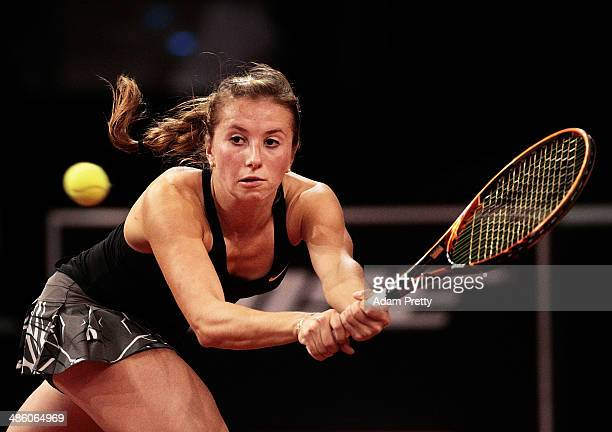Annika Beck of Germany hits a backhand during her first round match against Roberta Vinci of Italy during day 2 of the Porsche Tennis Grand Prix 2014...