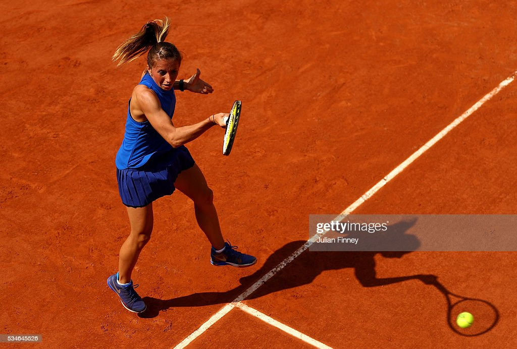 <a gi-track='captionPersonalityLinkClicked' href=/galleries/search?phrase=Annika+Beck&family=editorial&specificpeople=6249693 ng-click='$event.stopPropagation()'>Annika Beck</a> of Germany hits a forehand during the Ladies Singles third round match against Irina-Camelia Begu of Romania on day six of the 2016 French Open at Roland Garros on May 27, 2016 in Paris, France.