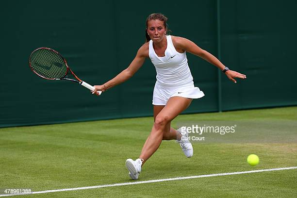 Annika Beck of Germany in action in her Ladies's Singles first round match against Kirsten Flipkens of Belgium during day one of the Wimbledon Lawn...