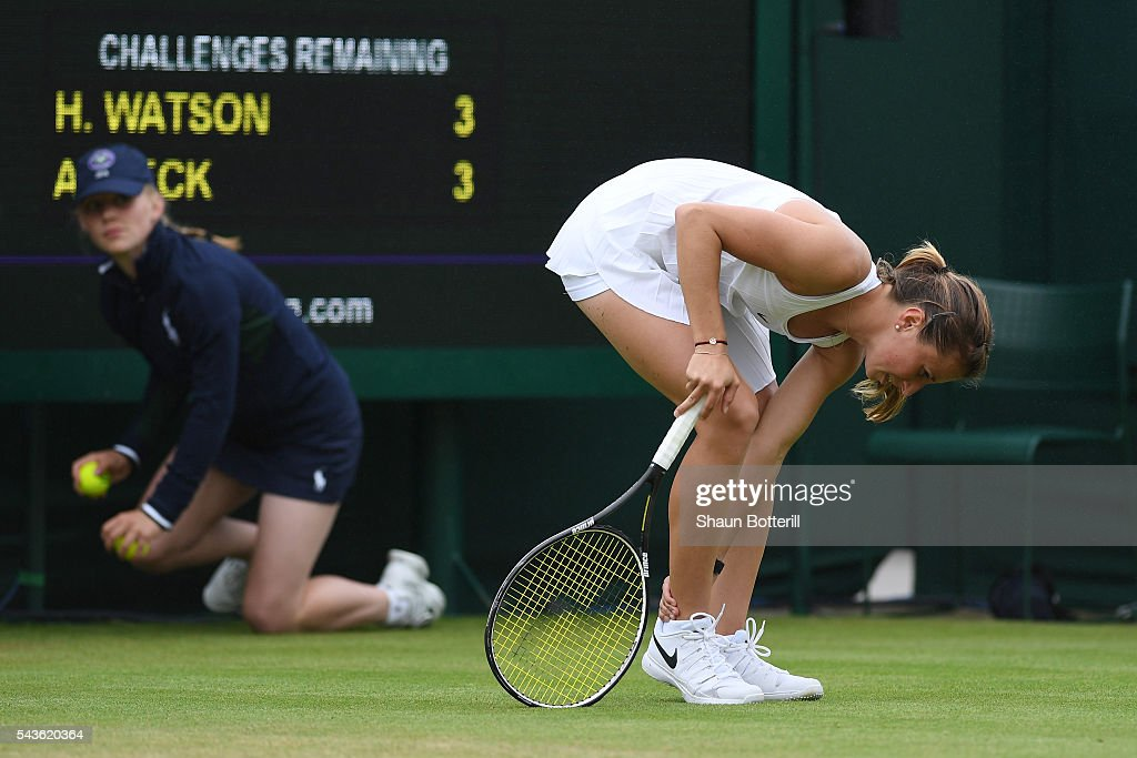 <a gi-track='captionPersonalityLinkClicked' href=/galleries/search?phrase=Annika+Beck&family=editorial&specificpeople=6249693 ng-click='$event.stopPropagation()'>Annika Beck</a> of Germany looks in pain during the Ladies Singles second round match against Heather Watson of Great Britain on day three of the Wimbledon Lawn Tennis Championships at the All England Lawn Tennis and Croquet Club on June 29, 2016 in London, England.