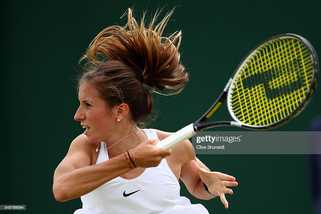 <a gi-track='captionPersonalityLinkClicked' href=/galleries/search?phrase=Annika+Beck&family=editorial&specificpeople=6249693 ng-click='$event.stopPropagation()'>Annika Beck</a> of Germany looks on after she plays a forehand during the Ladies Singles first round match against Heather Watson of Great Britain on day four of the Wimbledon Lawn Tennis Championships at the All England Lawn Tennis and Croquet Club on June 30, 2016 in London, England.