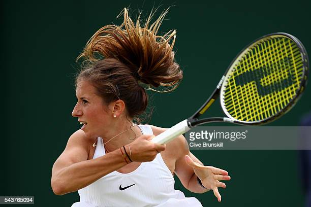 Annika Beck of Germany looks on after she plays a forehand during the Ladies Singles first round match against Heather Watson of Great Britain on day...