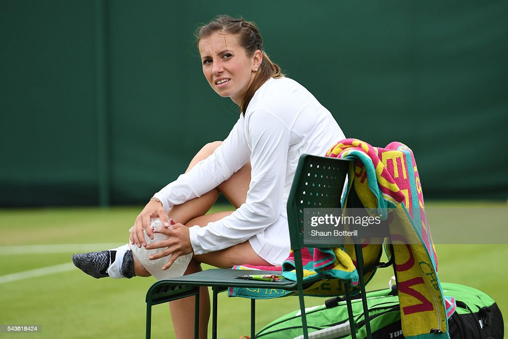 <a gi-track='captionPersonalityLinkClicked' href=/galleries/search?phrase=Annika+Beck&family=editorial&specificpeople=6249693 ng-click='$event.stopPropagation()'>Annika Beck</a> of Germany looks on in pain during the Ladies Singles second round match against Heather Watson of Great Britain on day three of the Wimbledon Lawn Tennis Championships at the All England Lawn Tennis and Croquet Club on June 29, 2016 in London, England.