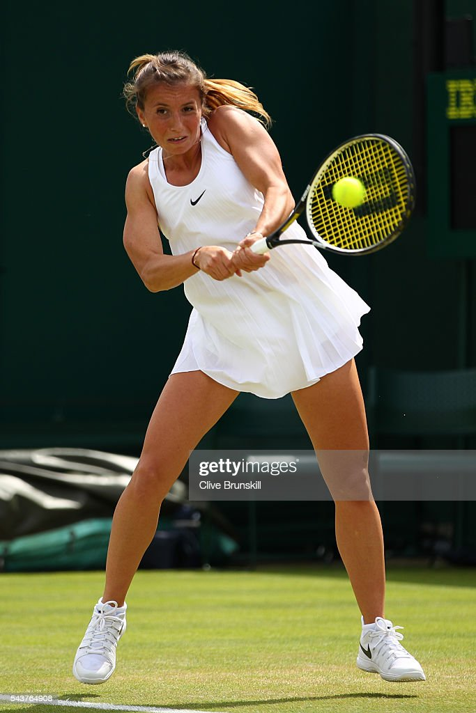 <a gi-track='captionPersonalityLinkClicked' href=/galleries/search?phrase=Annika+Beck&family=editorial&specificpeople=6249693 ng-click='$event.stopPropagation()'>Annika Beck</a> of Germany plays a backhand during the Ladies Singles first round match against Heather Watson of Great Britain on day four of the Wimbledon Lawn Tennis Championships at the All England Lawn Tennis and Croquet Club on June 30, 2016 in London, England.