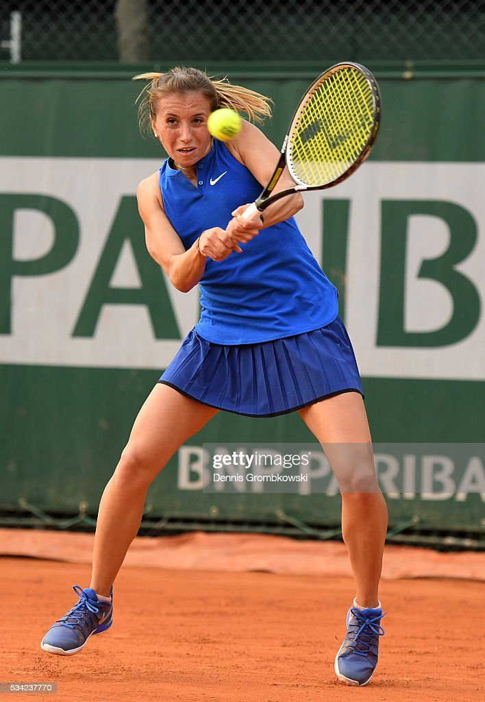 Annika Beck of Germany plays a backhand during the Women's Singles second round match against Kateryna Bondarenko of Ukraine on day four of the 2016 French Open at Roland Garros on May 25, 2016 in Paris, France.