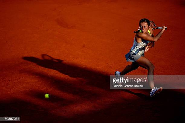 Annika Beck of Germany plays a backhand in her second round match against Karin Knapp of Italy during day five of the Nuernberger Insurance Cup on...