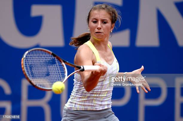 Annika Beck of Germany plays a forehand in her first round match against Nina Bratchikova of Russia during day four of the Nuernberger Insurance Cup...