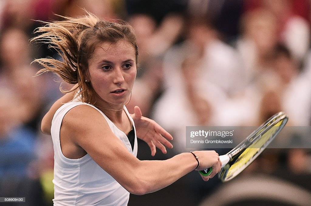 <a gi-track='captionPersonalityLinkClicked' href=/galleries/search?phrase=Annika+Beck&family=editorial&specificpeople=6249693 ng-click='$event.stopPropagation()'>Annika Beck</a> of Germany plays a forehand in her match against Timea Bacsinszky of Switzerland on Day 2 of the 2016 FedCup World Group Round 1 match between Germany and Switzerland at Messe Leipzig on February 7, 2016 in Leipzig, Germany.