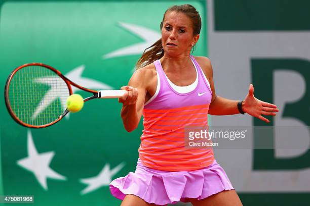 Annika Beck of Germany plays a forehand in her Women's Singles match against Elina Svitolina of Ukraine on day six of the 2015 French Open at Roland...