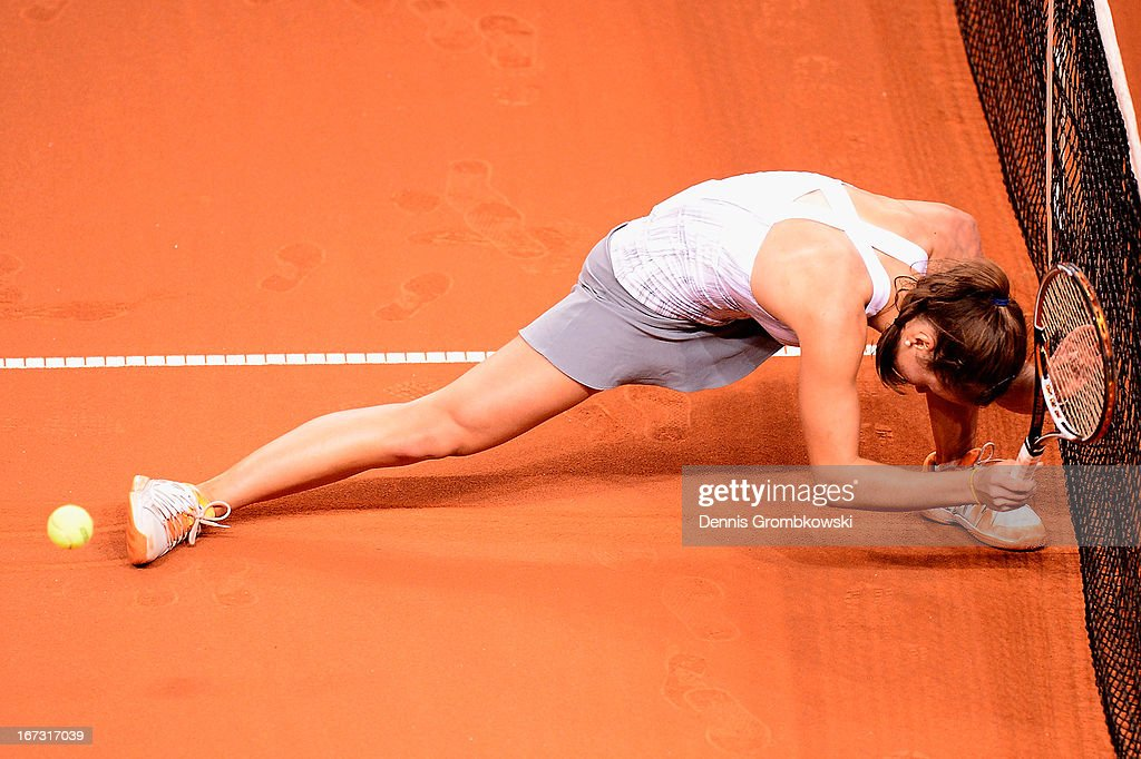 Annika Beck of Germany reacts during her match against Petra Kvitova of Czech Republic during Day 3 of the Porsche Tennis Grand Prix at Porsche-Arena on April 24, 2013 in Stuttgart, Germany.