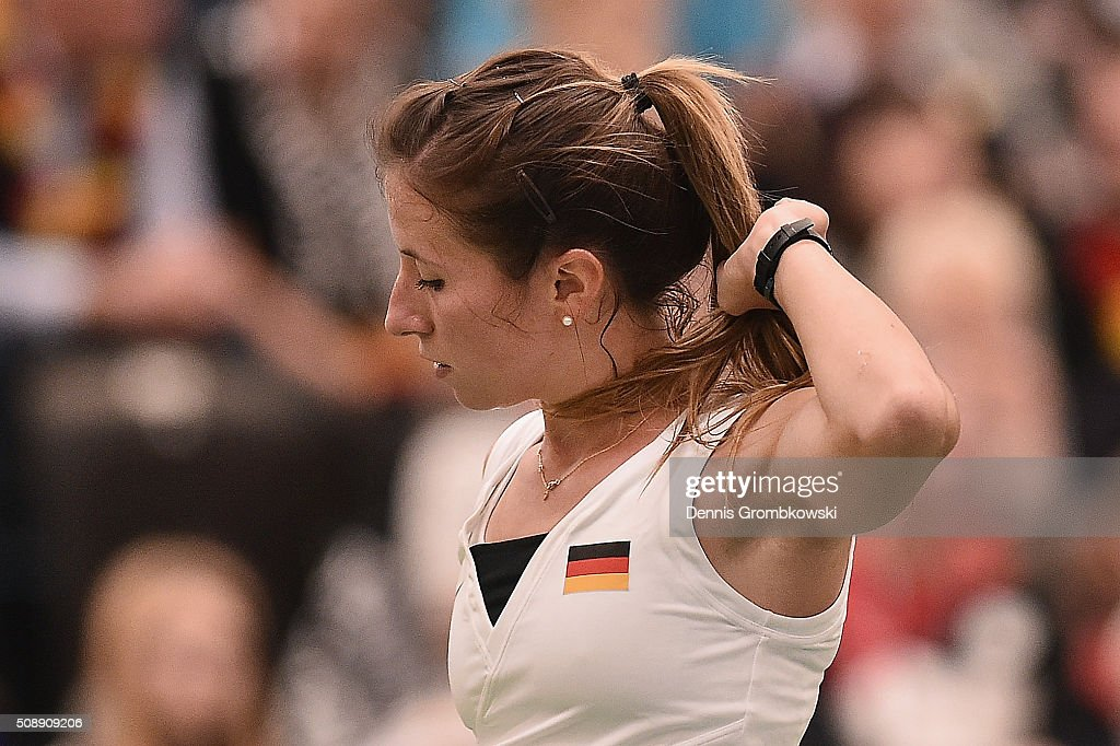 <a gi-track='captionPersonalityLinkClicked' href=/galleries/search?phrase=Annika+Beck&family=editorial&specificpeople=6249693 ng-click='$event.stopPropagation()'>Annika Beck</a> of Germany reacts during her match against Timea Bacsinszky of Switzerland on Day 2 of the 2016 FedCup World Group Round 1 match between Germany and Switzerland at Messe Leipzig on February 7, 2016 in Leipzig, Germany.