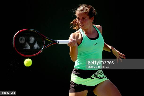 Annika Beck of Germany returns a shot to Christina McHale during the Miami Open at the Crandon Park Tennis Center on March 22 2017 in Key Biscayne...