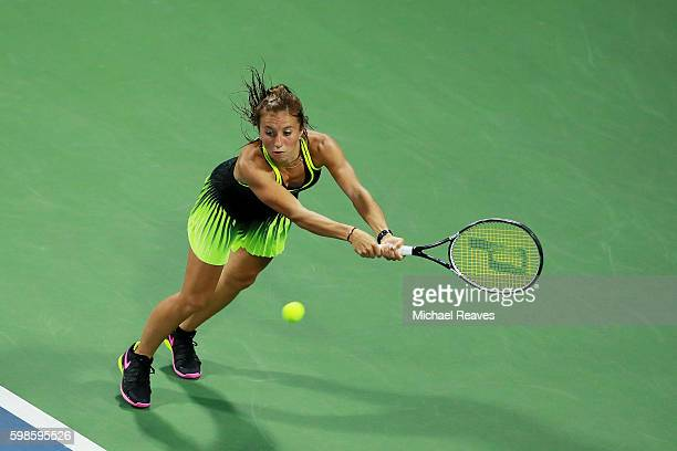 Annika Beck of Germany returns a shot to Elena Vesnina of Russia during her second round Women's Singles match on Day Four of the 2016 US Open at the...