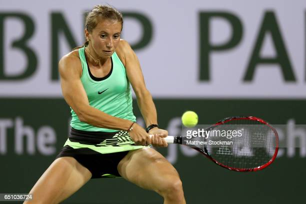 Annika Beck of Germany returns a shot to Eugenie Bouchard of Canada during the BNP Paribas Open at the Indian Wells Tennis Garden on March 9 2017 in...