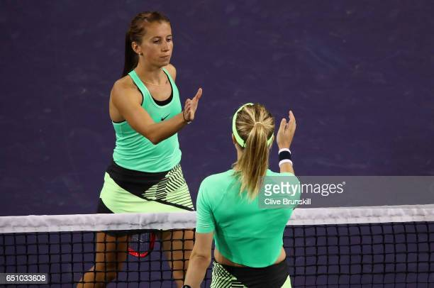 Annika Beck of Germany shakes hands at the net after her three set victory against Eugenie Bouchard of Canada in their first round match during day...