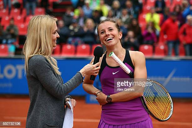 Annika Beck of Germany talks to presenter Petra Bindl after her match against AnnaLena Friedsam during day six of the Nuernberger Versicherungscup...