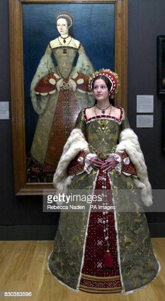 Annika Caswell a student from the Wimbledon School of Art wardrobe department dressed as Catherine Parr next to her portrait attributed to Master...
