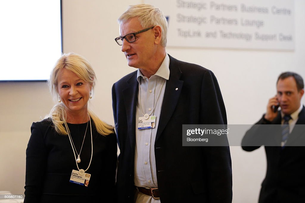 Annika Falkengren, chief executive officer of Skandinaviska Enskilda Banken AB, also known as SEB AB, left, and <a gi-track='captionPersonalityLinkClicked' href=/galleries/search?phrase=Carl+Bildt&family=editorial&specificpeople=3972090 ng-click='$event.stopPropagation()'>Carl Bildt</a>, Sweden's former prime minister, look on between sessions during the World Economic Forum (WEF) in Davos, Switzerland, on Wednesday, Jan. 20, 2016. World leaders, influential executives, bankers and policy makers attend the 46th annual meeting of the World Economic Forum in Davos from Jan. 20 - 23. Photographer: Matthew Lloyd/Bloomberg via Getty Images