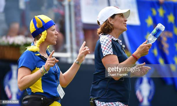 Annika Sorenstam Captain of Team Europe dances with Juli Inkster Captain of Team USA on the first tee during the final day singles matches of The...