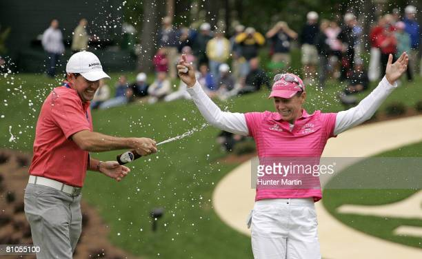 Annika Sorenstam of Sweden gets sprayed with beer by Mike McGee Managing Director of Annika Academy after winning the Michelob Ultra Open at...