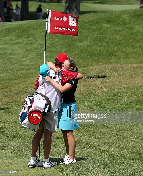 Annika Sorenstam of Sweden is embraced by her caddie Terry McNamara on the 18th green after making an eagle 3 by holing a 199 yard 6 iron shot during...