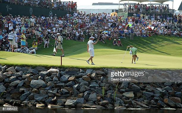 Annika Sorenstam of Sweden waves to the crowd after finishing one shot behind the winner at the 18th hole during the final round of the 2008...
