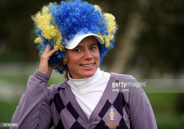 Annika Sorenstam of The European Team poses with the wig that she wore during the closing ceremony of the Solheim Cup at Halmstad Golf Club September...