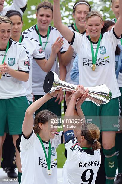 Annike Krahn and Inka Grings celebrate after the DFB Women's Cup final match between FCR 2001 Duisburg and FF USV Jena at RheinEnergie stadium on May...