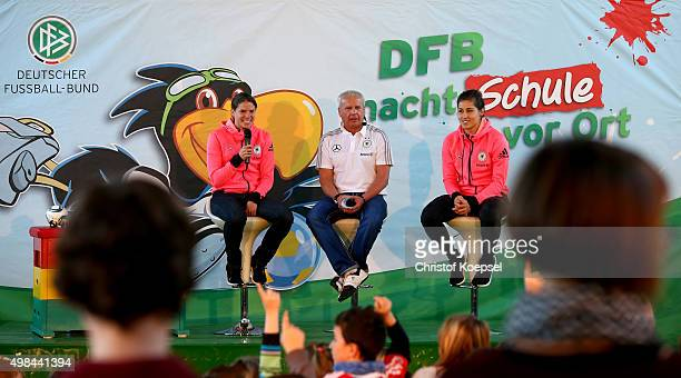 Annike Krahn mdoerator Wolfgang Staab Lisa Weiss of Germany Women's Football Team speak to school children during the visit of the...
