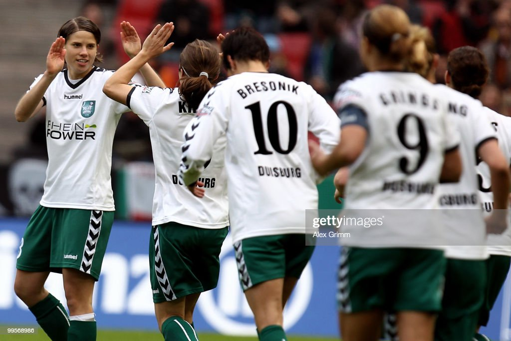 Annike Krahn of Duisburg celebrates her team's first goal with team mates during the DFB Women's Cup final match between FCR 2001 Duisburg and FF USV...