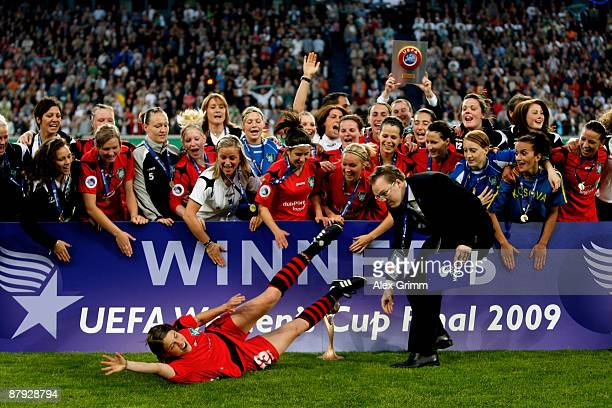 Annike Krahn of Duisburg slides over the pitch in front of the trophy after the UEFA Women's Cup Final second leg match between FCR Duisburg and...