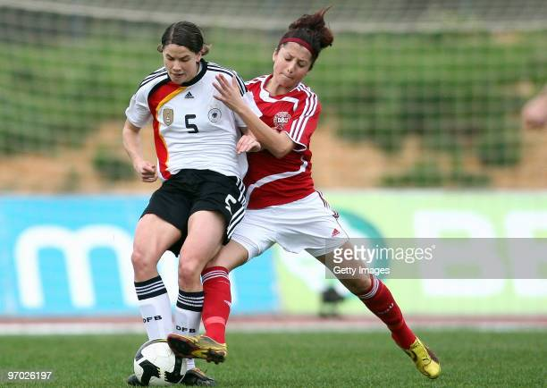 Annike Krahn of Germany and Nadia Nadim of Denmark battle for the ball during the Woman's Algarve Cup match between Germany and Denmark at the...