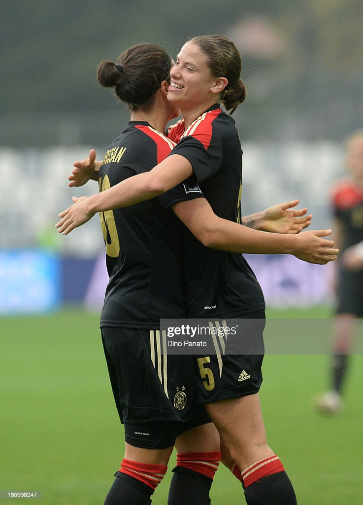 Annike Krahn (R) of Germany celebrates after scoring her team's fourth goal during the Qualifying Round - FIFA Women's World Cup between Slovenia and Germany at SRC Bonifika stadio on October 26, 2013 in Koper, Slovenia.