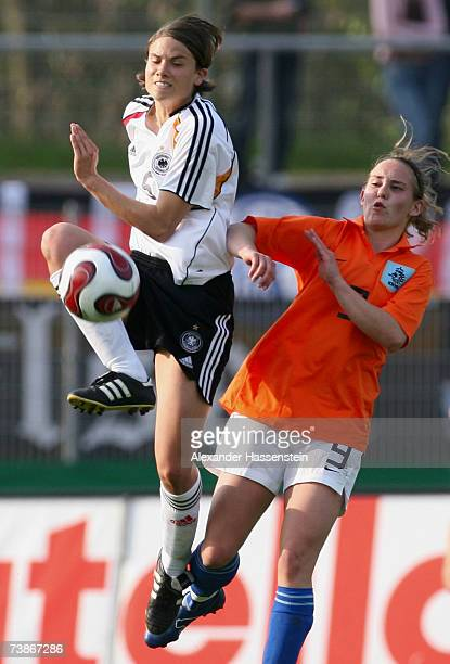 Annike Krahn of Germany challenge for the ball with Anouk Hoogendijk of the Netherlands during the UEFA Womens Championship qualification round match...