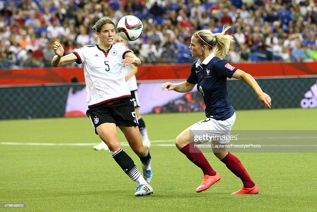 Annike Krahn of Germany challenges Eugenie Le Sommer of France during the FIFA Women's World Cup Canada 2015 quarter final match between Germany and...