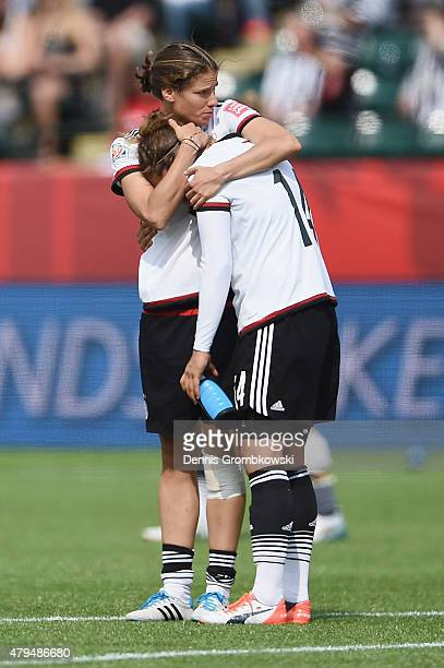 Annike Krahn of Germany hugs team mate Babett Peter after the FIFA Women's World Cup Canada 2015 Third Place Playoff match between Germany and...
