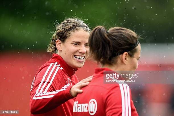 Annike Krahn of Germany reacts towards Dzsenifer Marozsan during a training session at Richcraft Recreation Complex on June 10 2015 in Ottawa Canada